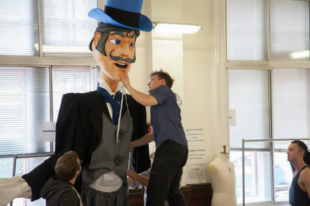 Students working with puppet 'John'