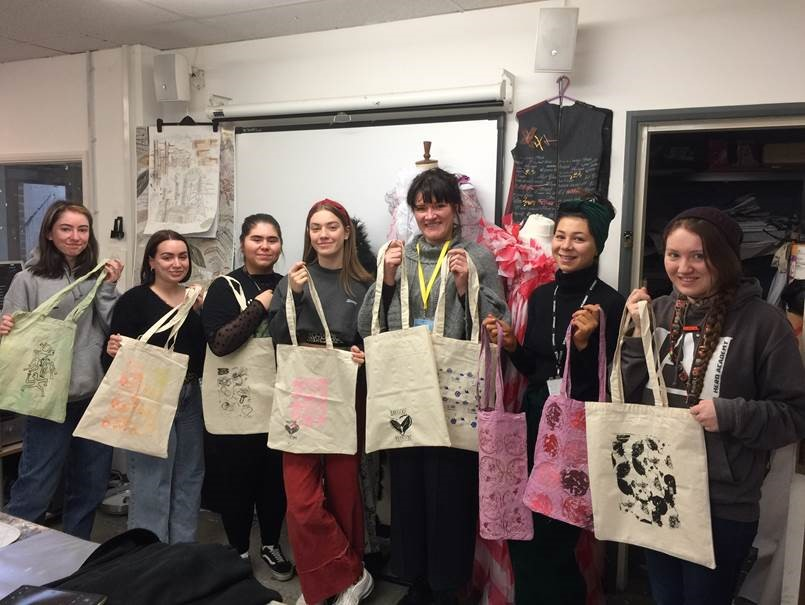 UAL Extended Diploma Textiles students with the bags they designed for Barefoot Kitchen