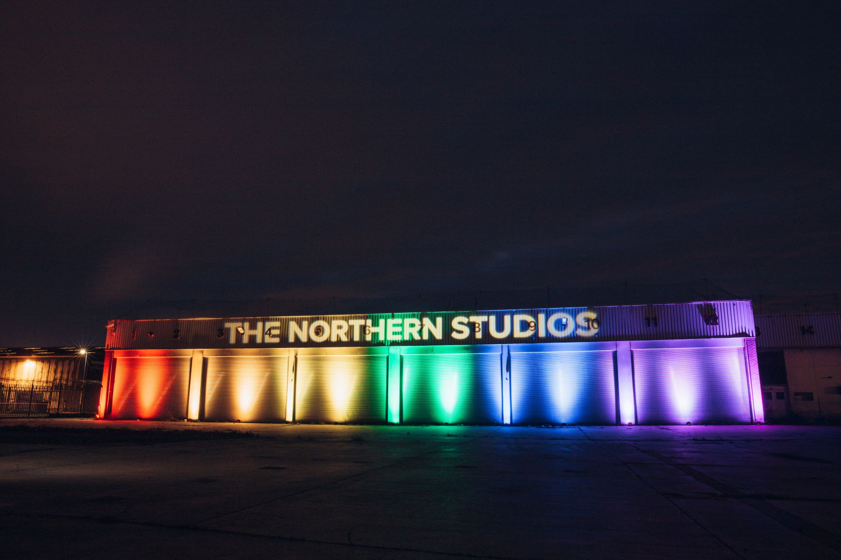 The front of the Northern Studios building illuminated