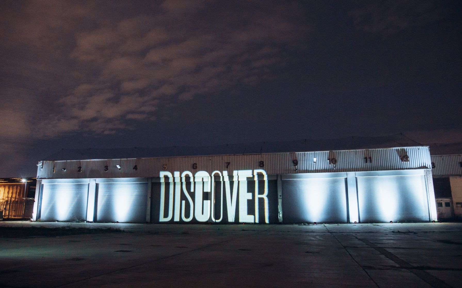 Discover illuminated on the front of The Northern Studios building