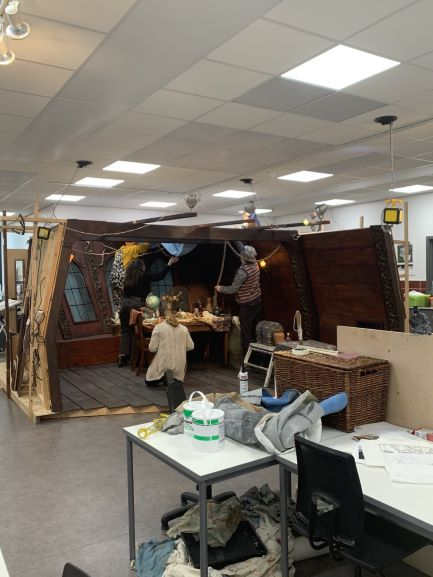 Students working on the Captain's Cabin set